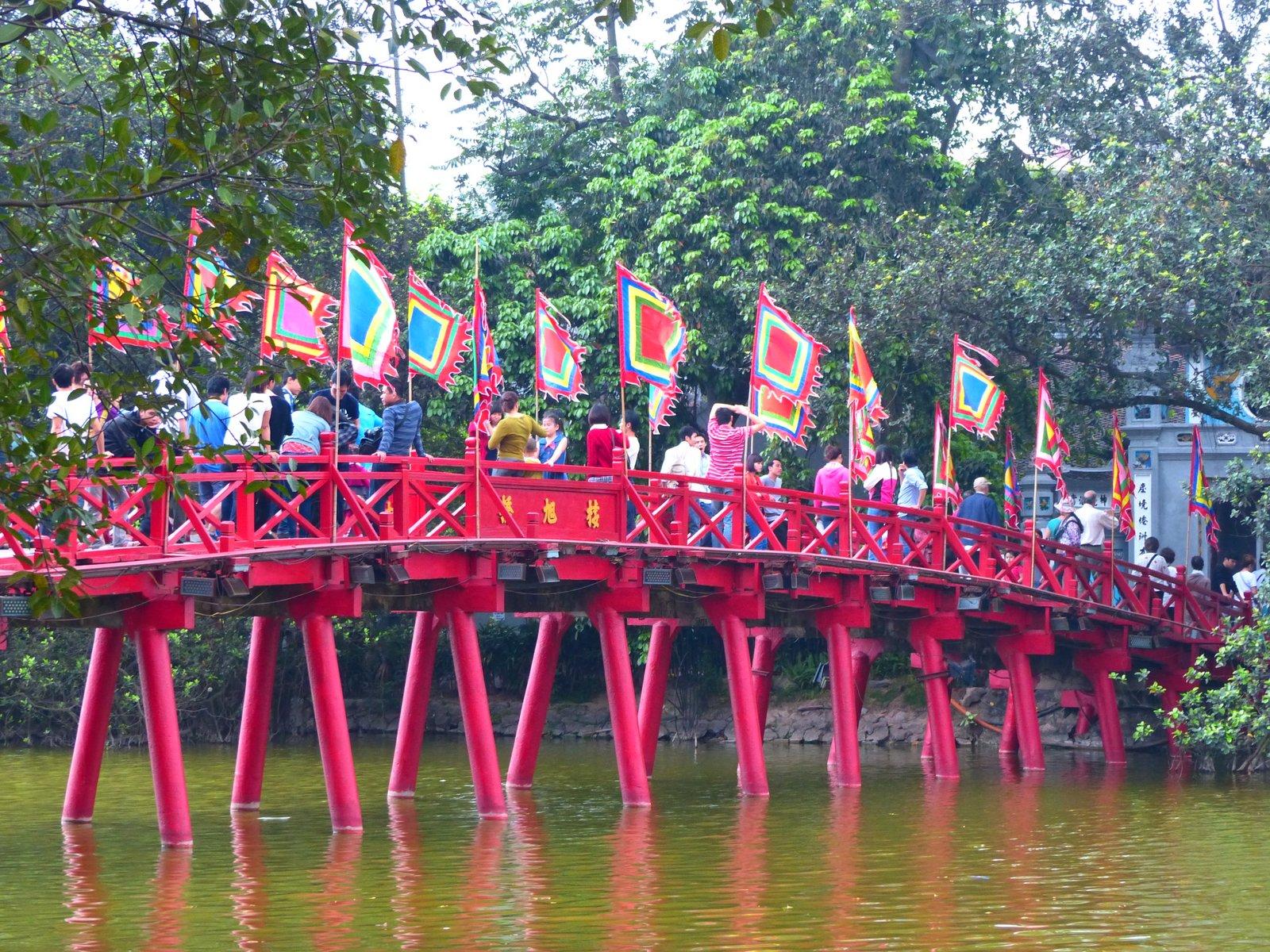 The Huc Bridge, leading across Hoan Kiem Lake to Ngoc Son Temple on Jade Island.