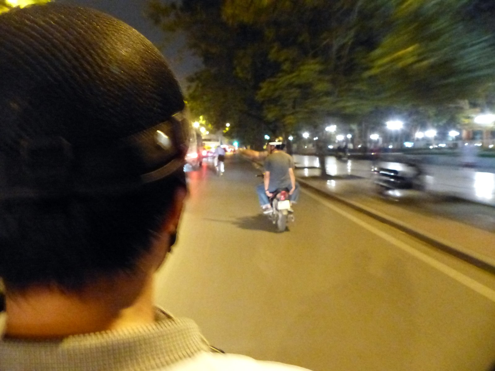 Riding scooters at night on a food tour of Hanoi. We met up with an expat chef, who took us around Hanoi and gave us some insight into the food culture here. Fun!