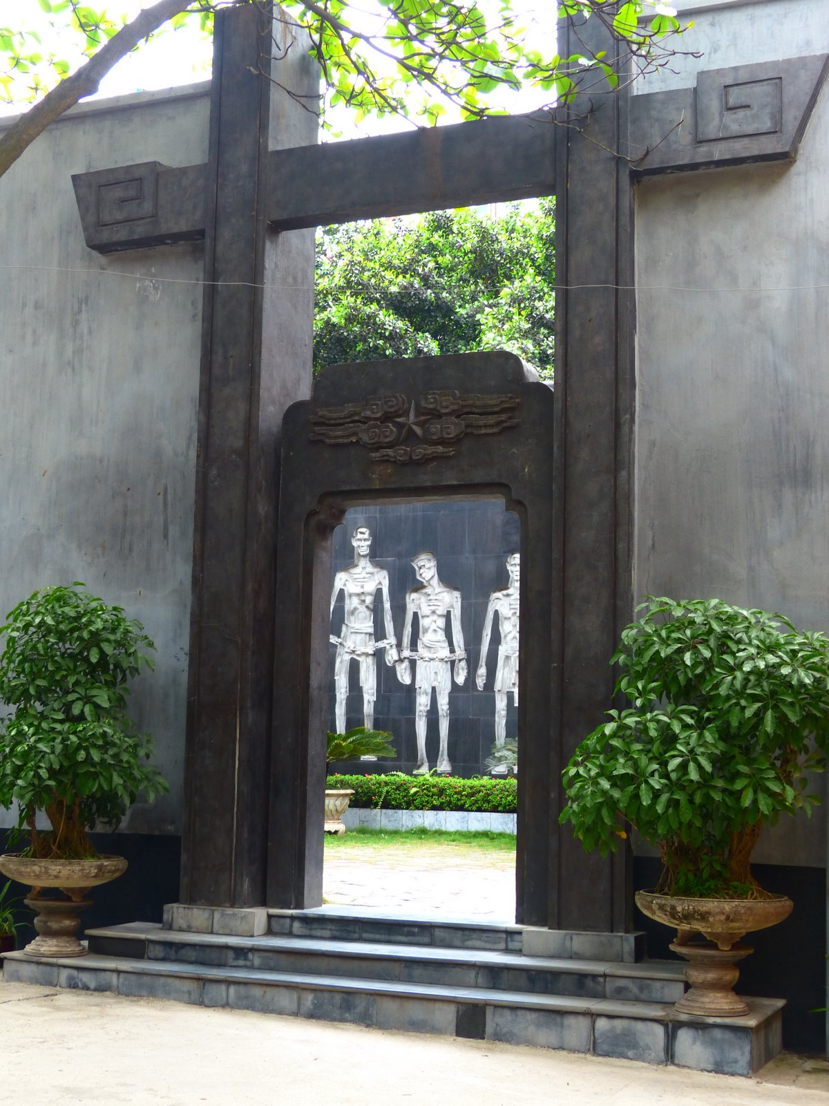 Peek at the memorial at Hoa Lo Prison, site of many French atrocities towards the Vietnamese people and now a museum and memorial.