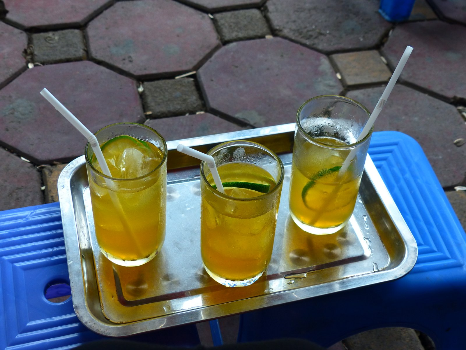 Tra Chanh, or lemon tea. It is a custom to sit on little plastic stools on the sidewalk of a cafe here and drink tra chanh. It's where you go to catch up with your friends and watch the world go by.