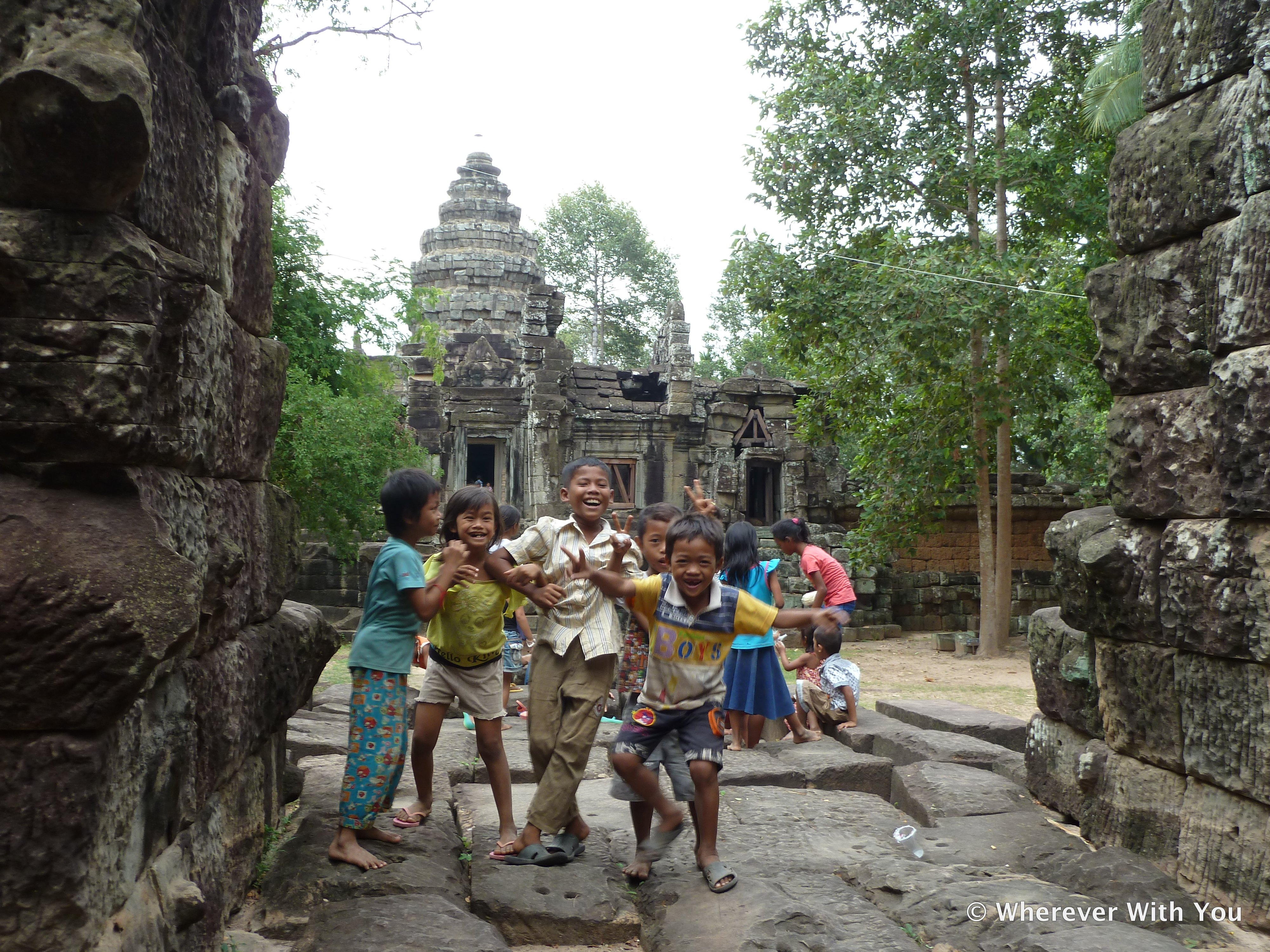 Children celebrating the final day of the Khmer New Year (and also excited to meet Americans).