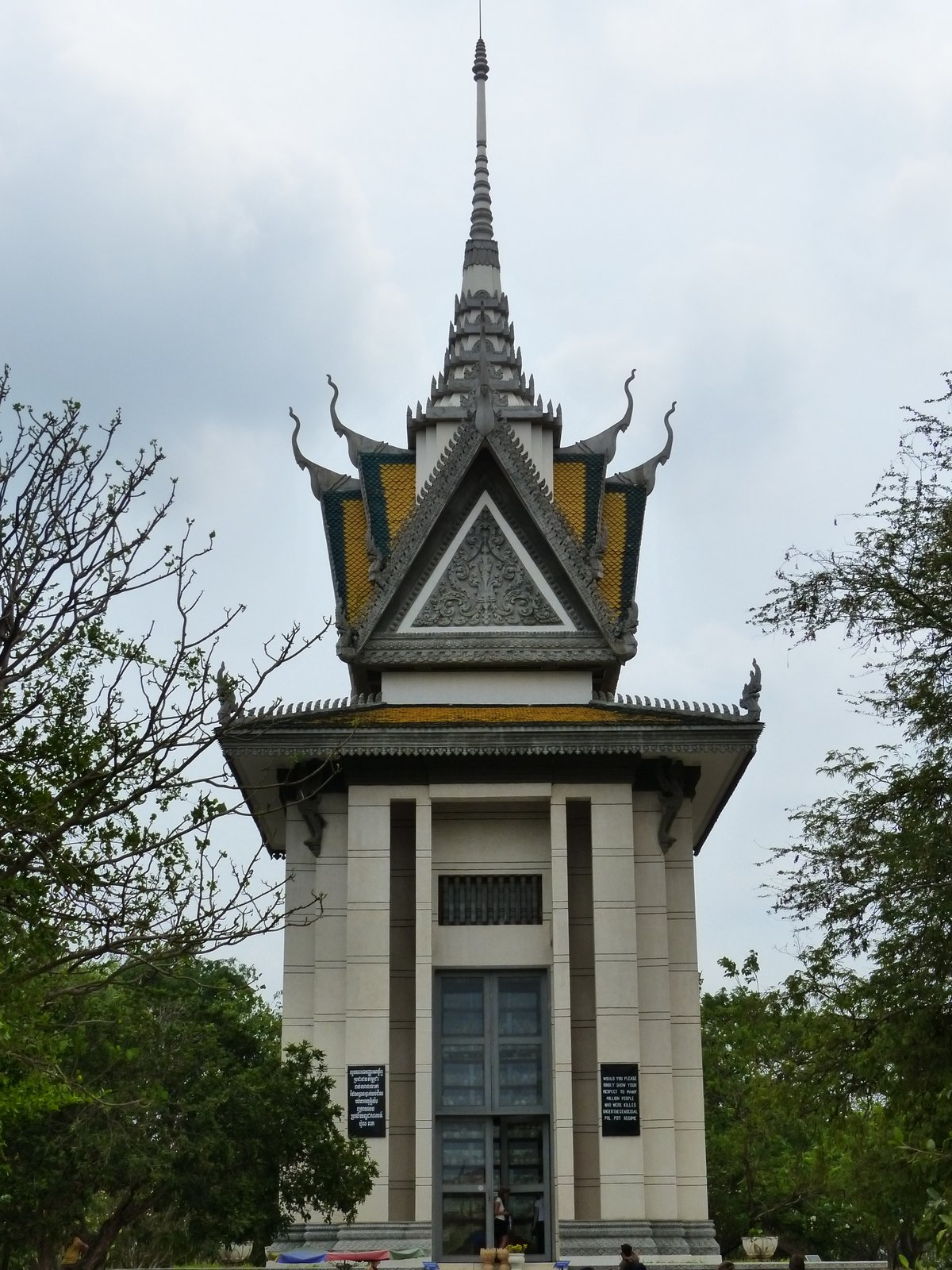 Memorial Stupa at Choeung Ek, containing the skulls of victims in 17 different levels. Combining both Buddhist and Hindu imagery, it is a sacred memorial to the more than 17,000 people who were executed here.