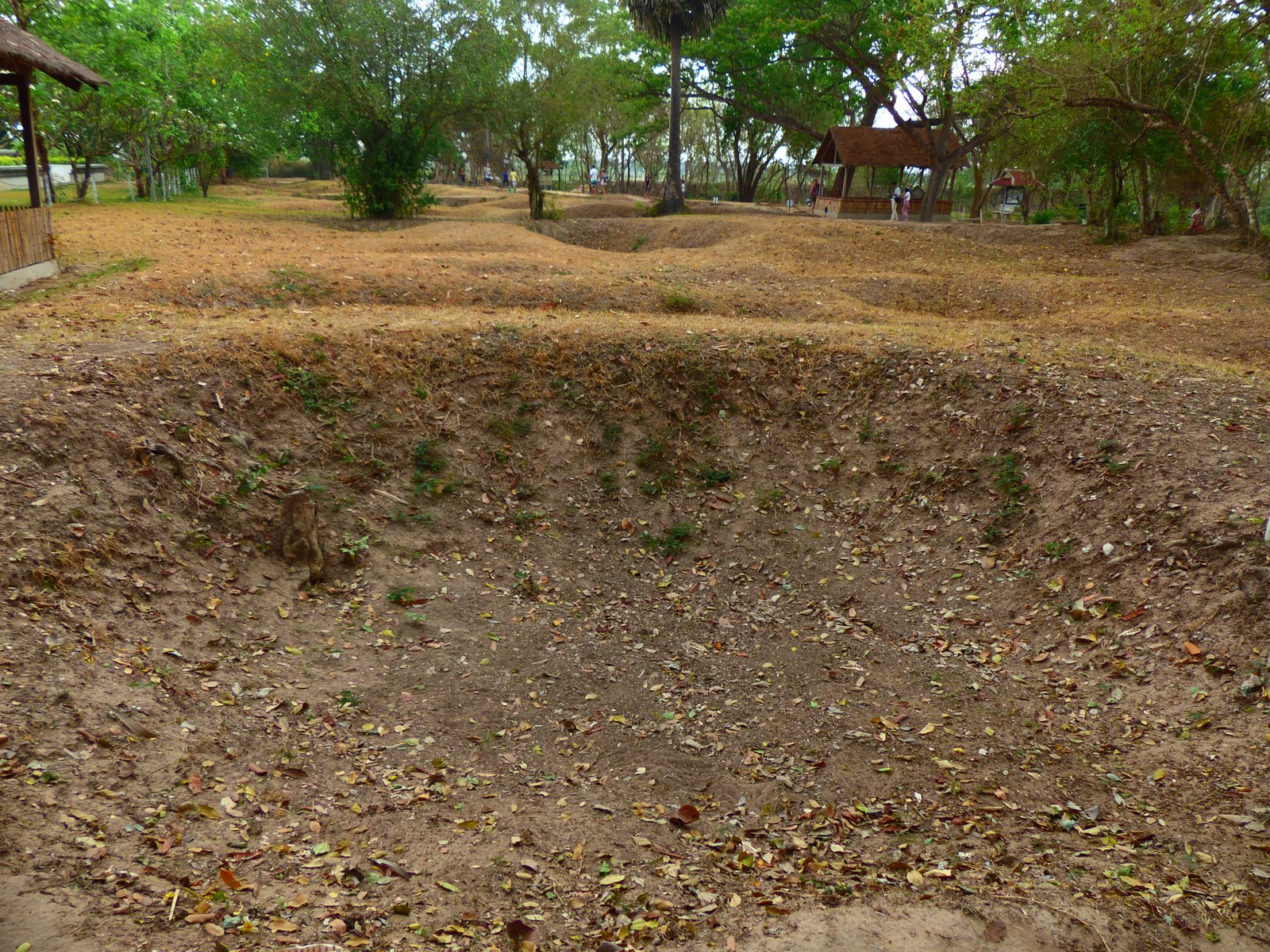 Mass graves at the Killing Field of Cheoung Ek. An estimated 17,000 victims were executed on this field and buried here in mass graves.