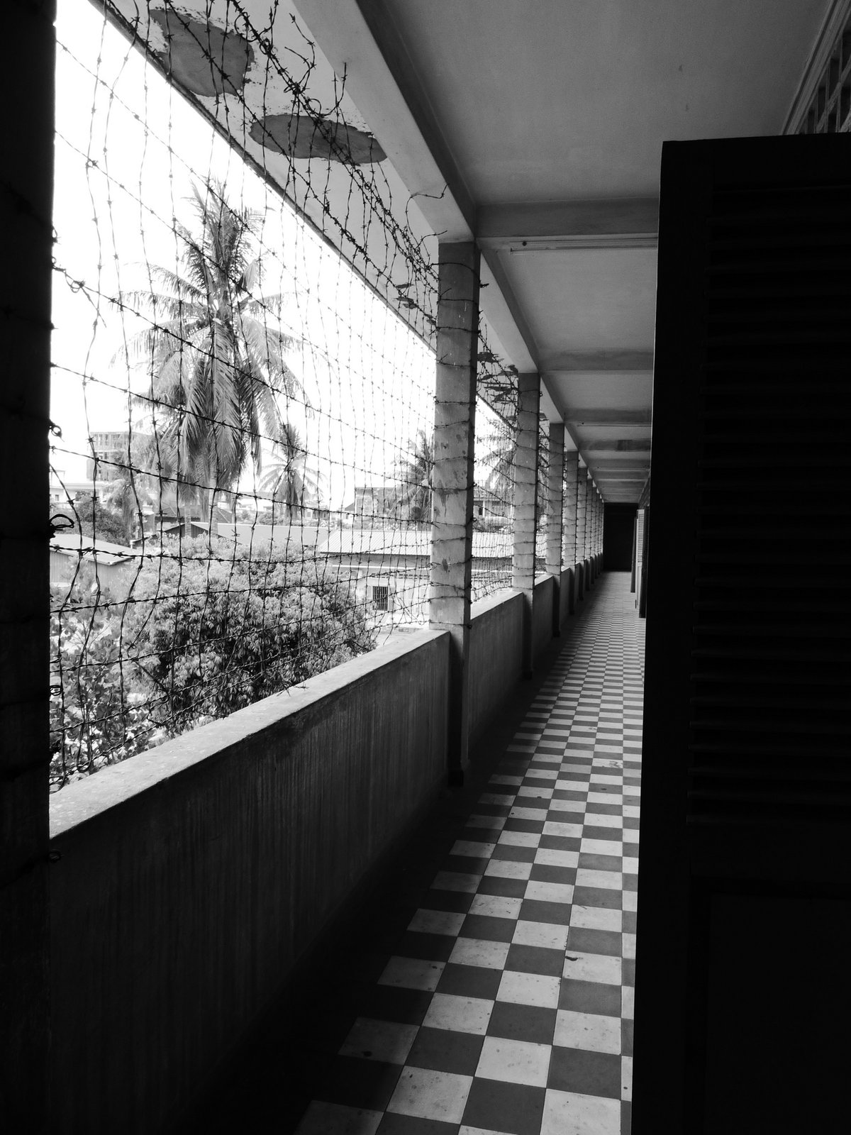 Hallway at Tuol Sleng Prison. The Khmer Rouge used barbed wire and turned classrooms into mass cells to make this former high school into a horrific prison.