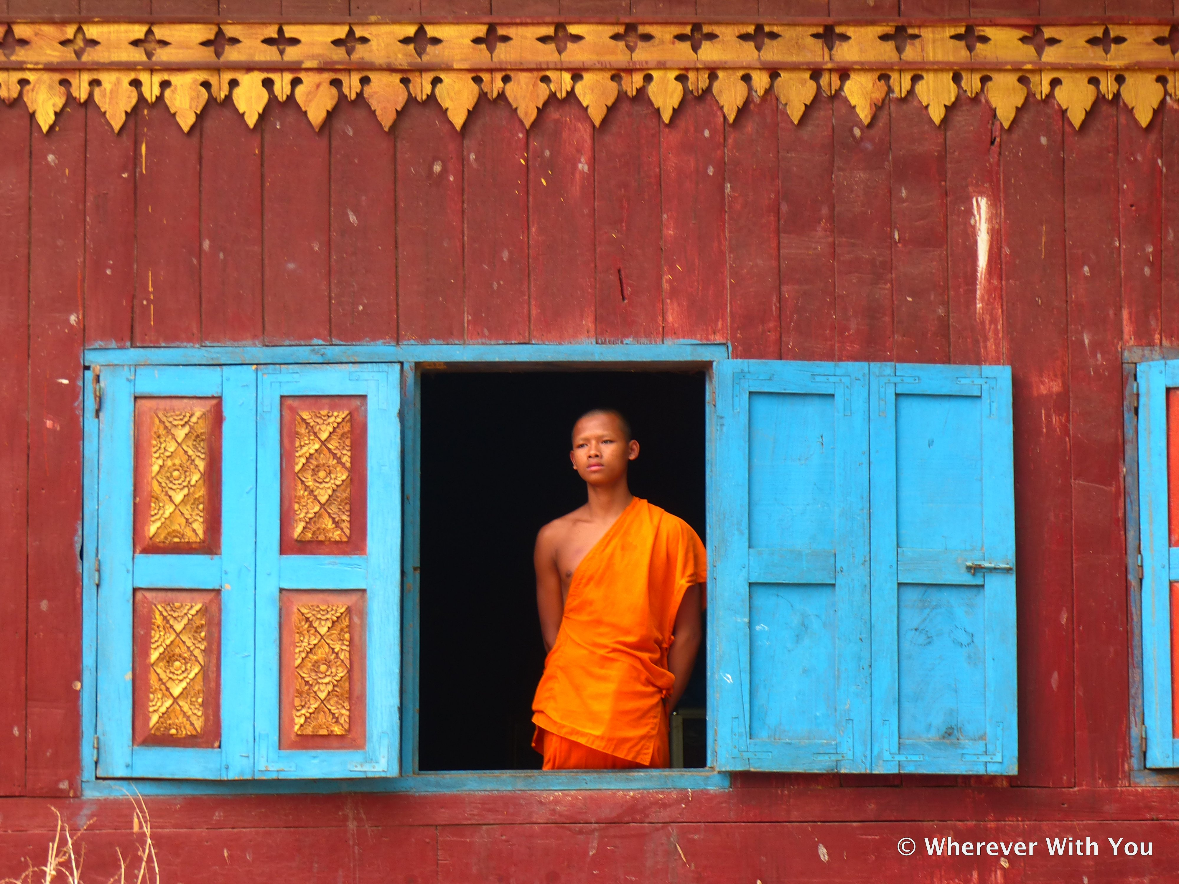 A young monk, watching some of the Khmer New Year festivities.
