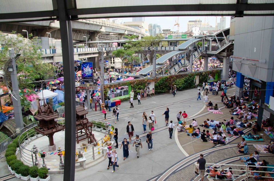 The scene outside MBK Center (one of the larger malls in Bangkok). You can see beyond the stairs to the mass of people in the street.