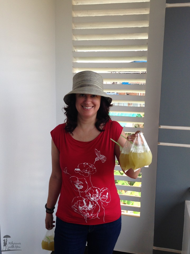 Kat with some sugar cane juice. We recently discovered that it is a superfood. Chock full of vitamins & minerals, has a low glycemic index, fights tooth decay, and super tasty. It's actually better for you than wheatgrass juice and tastes a hell of a lot better too!