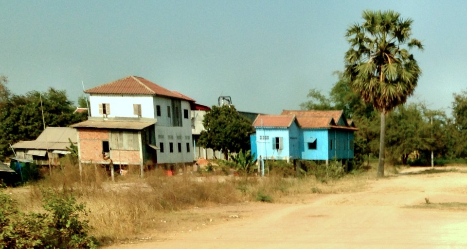 Some traditional Khmer homes along the side of the road.