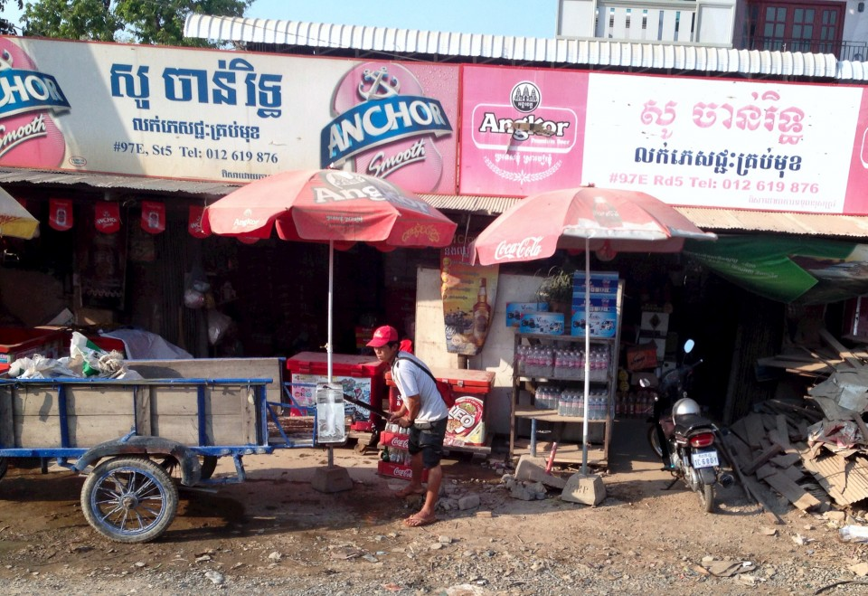 The Iceman Cometh! Ice delivery at one of the roadside convenience stores. Most people don't have refrigerators here.