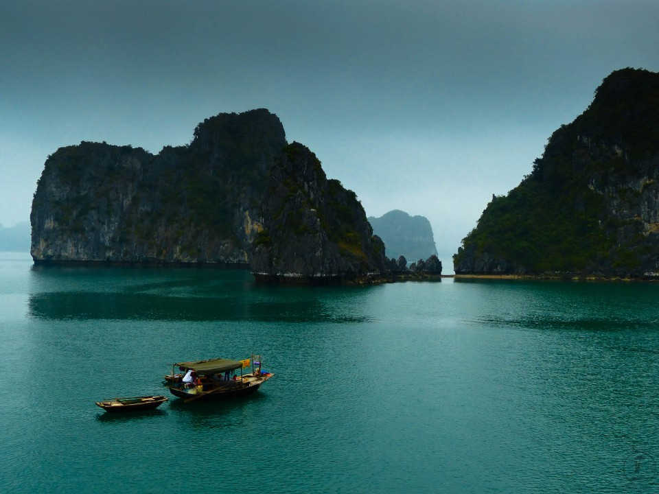 15 May, 2014 ~ A local fishing boat on a misty day in Halong Bay, Vietnam.