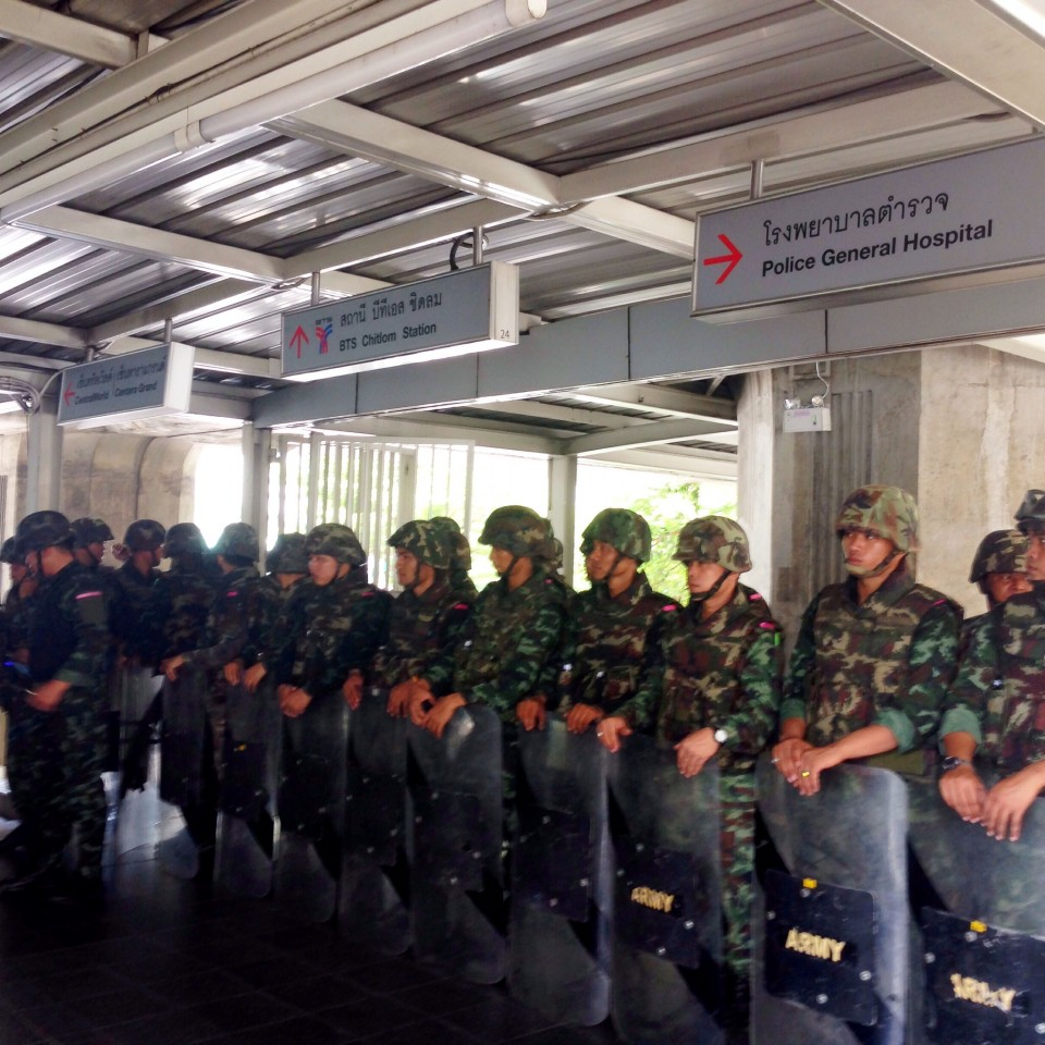Soldiers gathered at the Ratchaprasong BTS Station in advance of an anti-coup protest. We came off the Skywalk and bumped right into them.