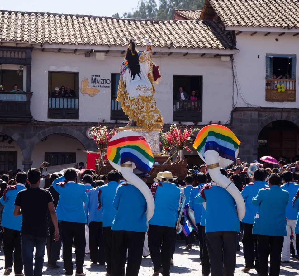 Santiago makes his way, followed by a colorful marching band.