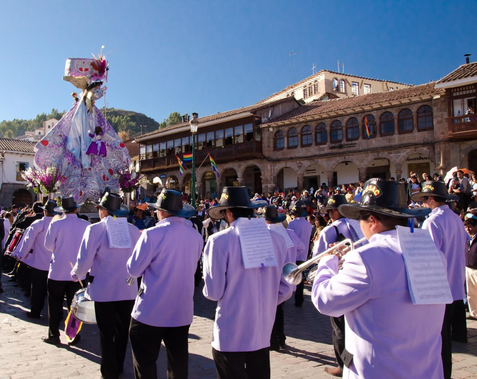 Virgen Purificada, followed by a marching band, makes her way around the plaza.