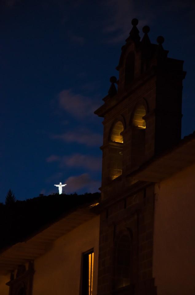 White Christ Statue at night from Plazoleta Nazarenas.