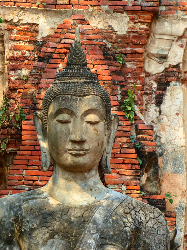 One of the few Buddhas with its head still intact at Wat Mahatat
