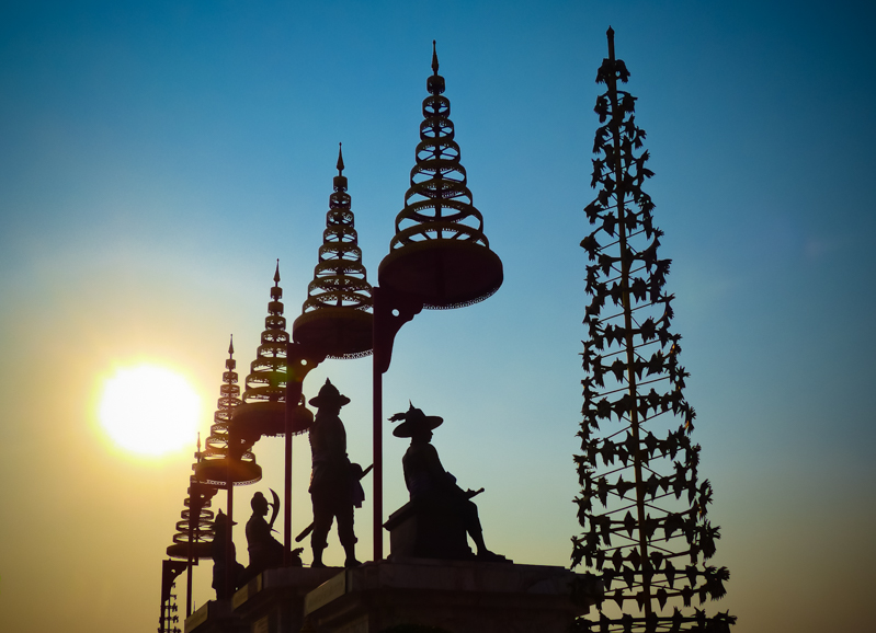 Sun sets over shrines to some of Thailand's early Kings at Wat Phutthaisawan.