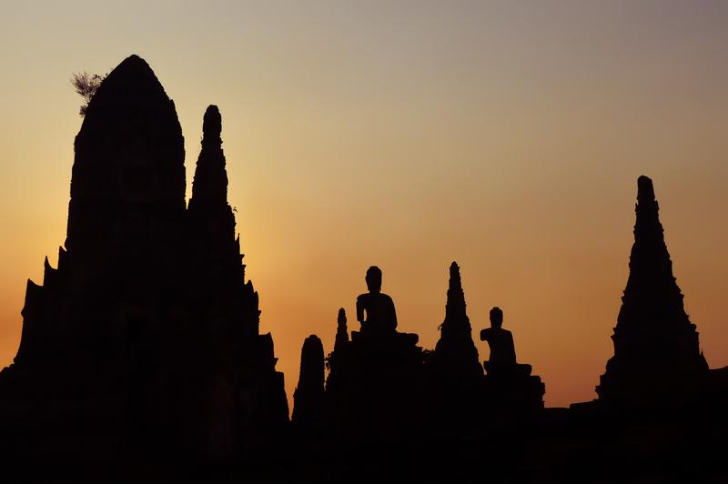 The sun sets over Wat Chaiwatthanaram along the Chao Phraya river.