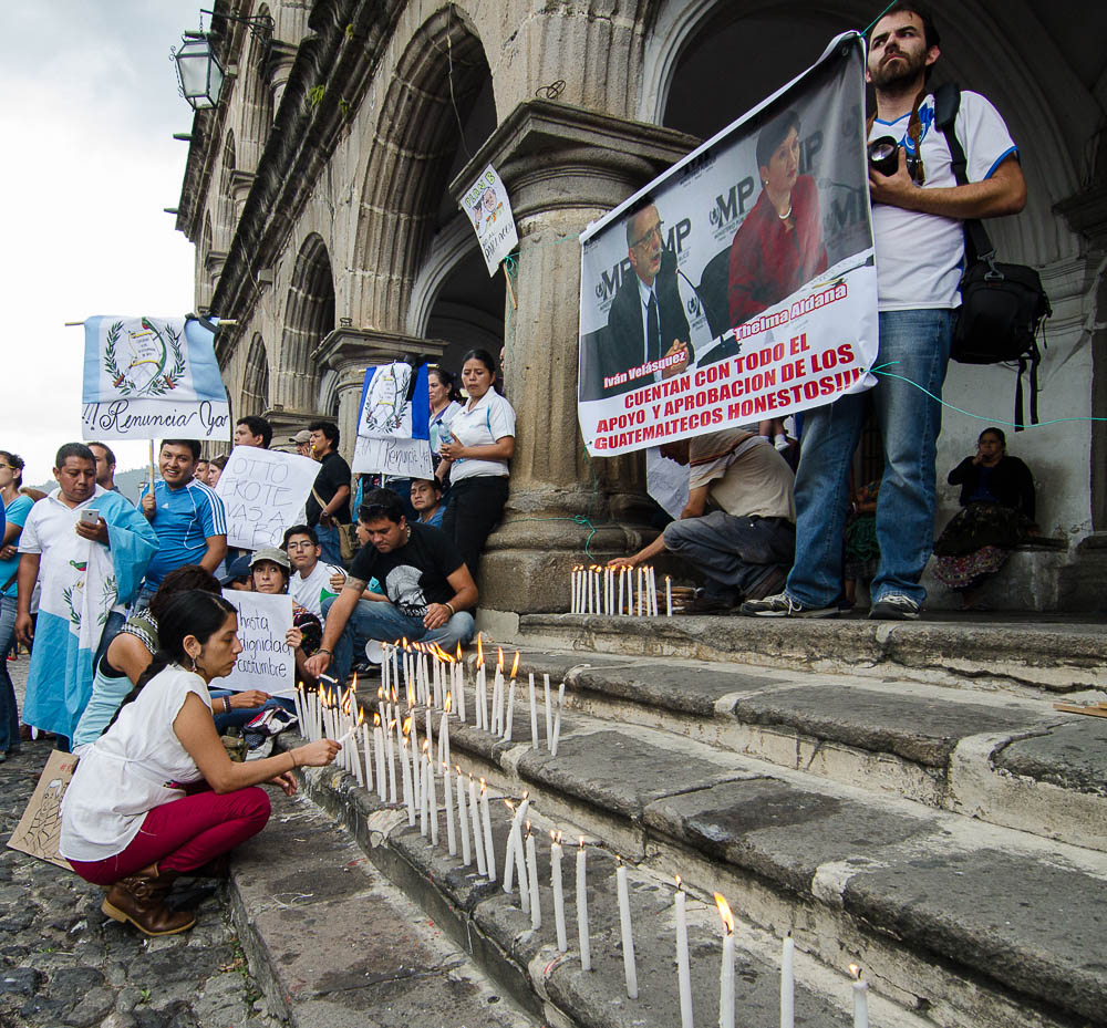 Lighting candles on the steps of city hall during the local protests of the National Strike on August 27th.