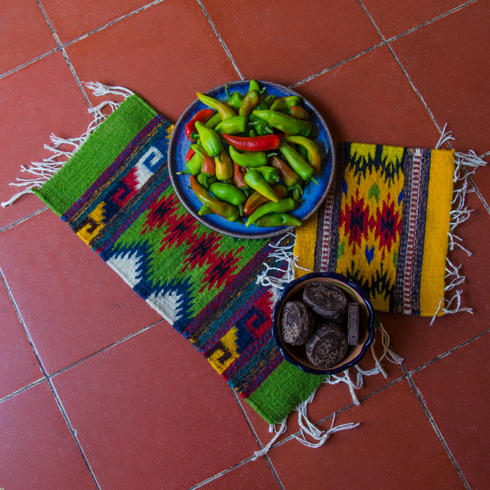 {Some purchases from my trip to San Miguel del Valle this week. Fresh chiles, beautiful weavings, and freshly made chocolate}