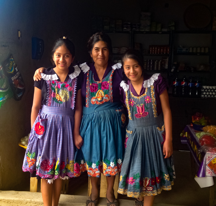 {Maria and her lovely daughters in San Miguel del Valle. Maria runs a tienda and she's growing her business with the help of En Via - a local nonprofit I volunteer with.}