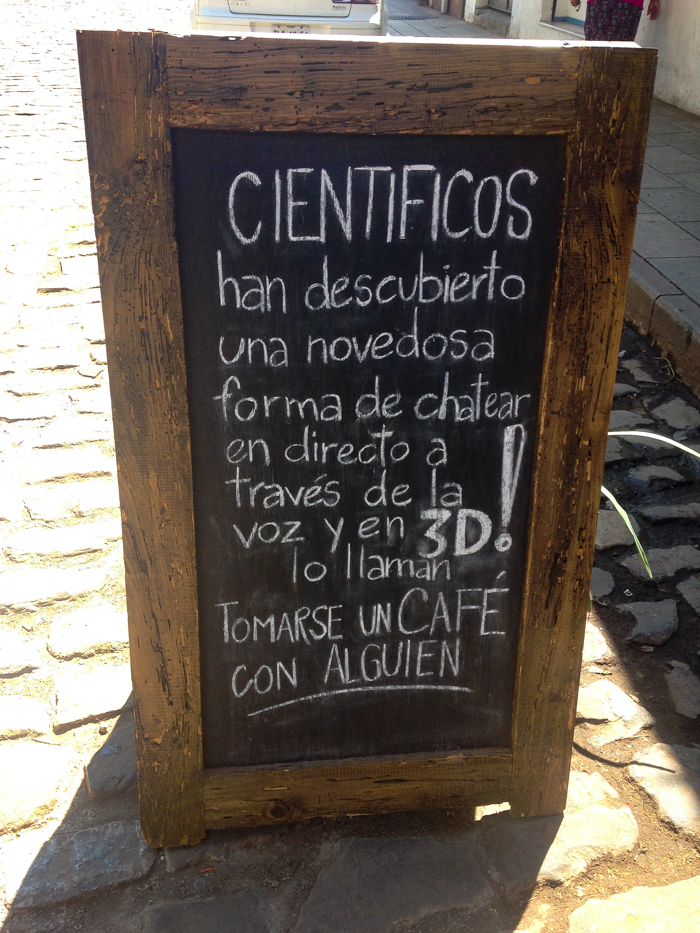 {Clever sign at one of my local cafés. Scientists have discovered a novel way to chat live and in 3D. Have a coffee with someone.