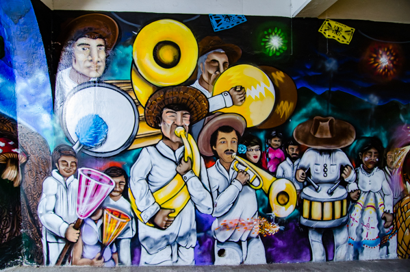 {A banda brightens up the tunnel on the way to the Ampitheater here in Oaxaca.}