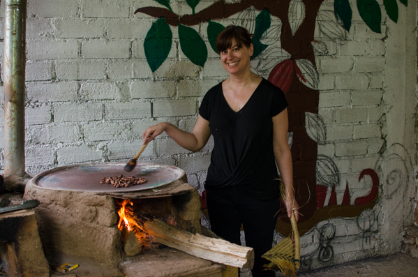 {We took a chocolate workshop this week with Cooperativa Autónoma de Convivencia y Apprendiizaje de Oaxaca – or C.A.C.A.O. We made chocolate from scratch, starting with raw cacao beans. Here's Kat toasting up some cacao beans on the wood fired comal.}