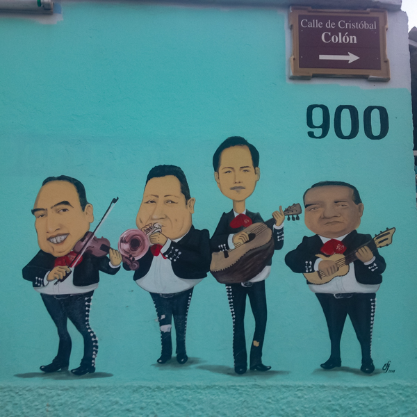 {You can hire this mariachi band to play at your events. A close up of their sign.}