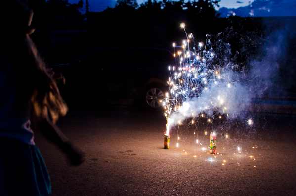 {Street Fireworks with the family. My mom bargained with the store manager and got all the fireworks for half off. So we had 90 minutes of fun for about $30.}