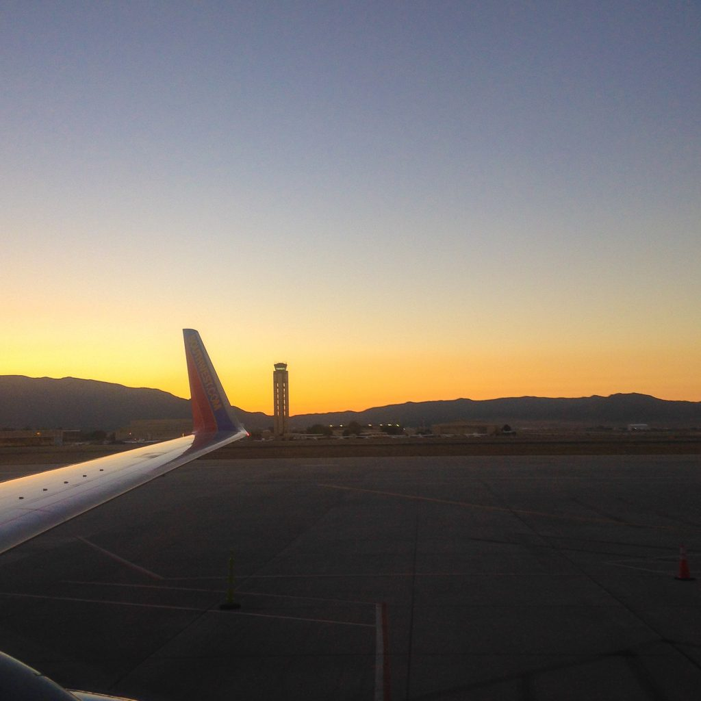 {Watching the dawn over the Sandia Mountains as I headed out of ABQ on Tuesday}