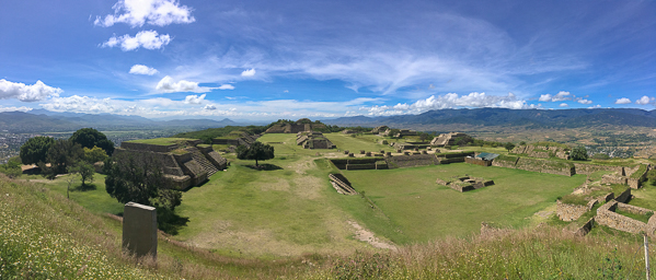 {It was a lovely morning to visit Monte Alban, one of the oldest cities in Mesoamerica. Located high on a mountaintop above the Oaxaca valley, Monte Alban was the social and political center for the Zapotec people of this area for more than 1,000 years (from 500BC to 750AD), before being abandoned.}