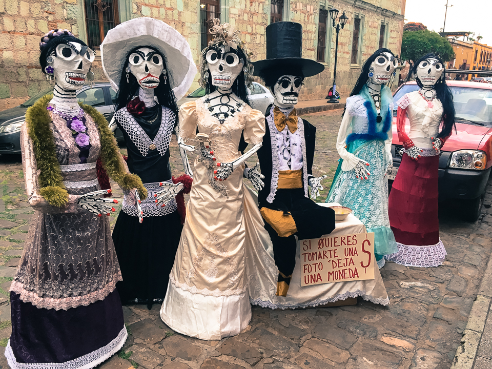 "{Day of the Dead is in the air. There was a little boy looking at this with uncertainty when we were there. I asked him, ""Que piensas?"" - what do you think - and he just looked at me all wide-eyed and then looked back at the paper mache people as if they were the scariest weirdest things he had ever seen."