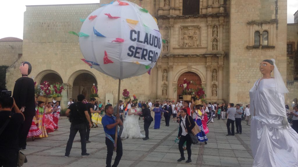 {Wedding celebration in front of Santo Domingo, complete with 2 bands, globos, gigantes, and dancers.}